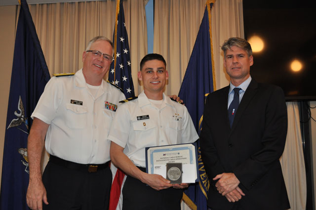 Capt. Rounds with President of S.U.N.Y. Maritime College Rear Adm. Michael Alfultis, Ph.D. presenting the ECO award to Cadet Zachary Worthington  in April 2018